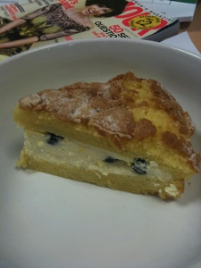 orange sponge cake with a filling of mascapone cheese and blueberries