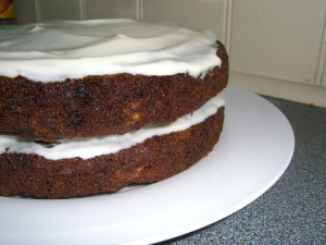 Carrot cake with cheese cream icing side view