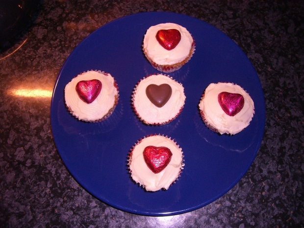 Hummingbird Bakery vanilla cupcakes with vanilla icing and heart shaped chocolates