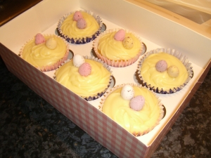 with mini eggs in pink gingham cupcake box