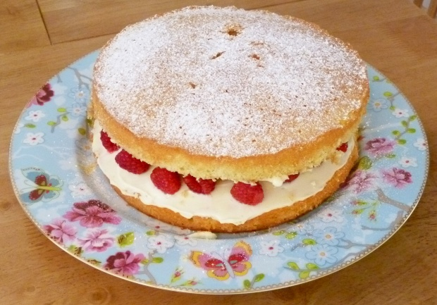 whole raspberry courting cake on Pip Studio cake plate
