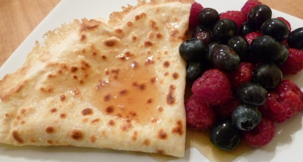 Raspberry, blueberry and maple syrup pancake